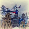 "January 19, 2011 - ""Texas Wind Power""<br /> <br /> This image should work for my next edition of my Vintage Grapevine book.  These garden well wind mills are for sale at the Grapevine Feed Store."