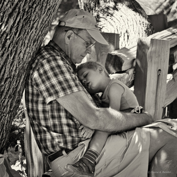 A Grandfather and Grandson take a break along the trail