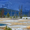"""Nature At Work""<br /> <br /> This was shot from West Thumb Geyser Basin in Yellowstone Park.  Lighitng had started some fires across the lake that jumped the road, so the road to Mammoth Lakes was closed.  We then took a 5 hour detour through Idaho and Montana to get to our cabin in Mammoth Lakes.  It was a about 14 hour journey from that first  Mormon Barn shot until we arrived that night.  But it was an extremely rewarding and enjoyable day!"