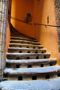 "September 8, 2010 - ""Old Stairs""  It was fairly dark in this stairwell but with enough indirect midmorning sunlight for an ISO 3600 shot to pick up the different light created  tones.  This was shot  in old town in Lyon, France.   The stairway is in a narrow passage way in a dense area of at minimum 4 story high apartments,  The holes in the stairs provide light to the basement area below.  The architecture in the area is 15th century Gothic.  The density of the buildings can be seen in my previous post  http://www.dakotacowboyphotography.com/Daily-Photos/PHOTOGRAPHY-Daily-Photos-2010/10826175_mje4B#983185480_9US4Z"