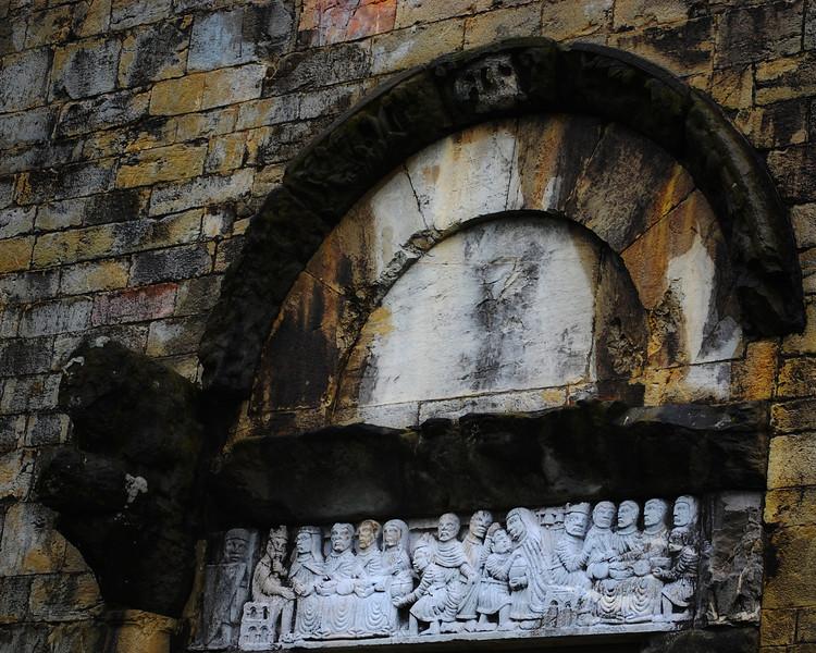 """""""Door Sculpture"""" <br /> <br /> Art work above a door in the ancient city of Barga, Italy."""