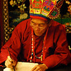 Naxi dongba priest writing hieroglyphs.  They're the priests from the old animist religion that's traditional in central Yunnan