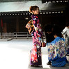 Lady out for sunday at the shrine in a beautiful kimono.  The kids were in crazy japanese outfits as well