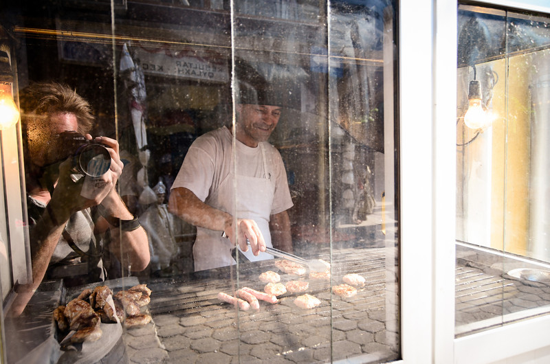 Here's a man grilling Kebaps (that's how they spell it)