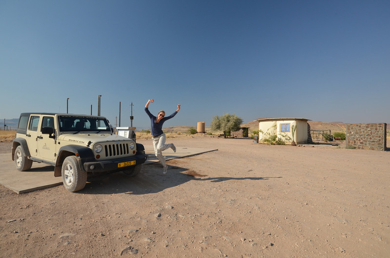 Road trip Namibia:  We did a lot of driving.  Shelda is celebrating arriving at Palmwag petrol station.  Anne (our jeep) was always thirsty.