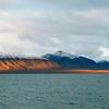 Midnight sun plays on Woodfjord in northern Spitsbergen