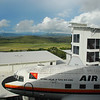 View from the roof-top restaurant across the airfield and onto the Owen Stanley Mountains, where the Kokoda Trail starts