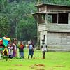 At the plantation village the fruit & veg sale was attracting business despite the downpour