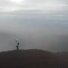 Shelda contemplates the vast volcano