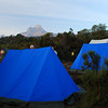 First camp which was nice and warm just out of the monkey infested forest on the lower slopes.  The jagged peak in the background is another peak in the Kilimanjaro complex called Mawenzi. (2,600m asl)