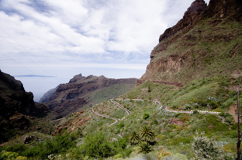 Behind the cliffs are deep canyons with spaghetti roads and tiny villages