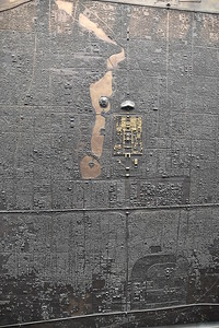 It also has a giant etched metal map of the city hanging off one of the walls ...