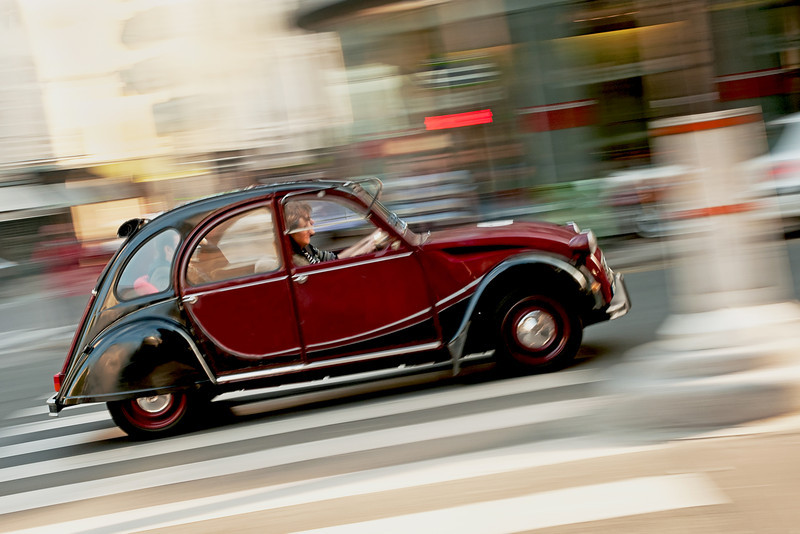Old Citroen car using 'panning' technique.  The camera has to move at the same speed as the car.