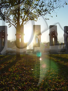 Sunset shining through the National World War II Memorial in Washington, DC.