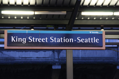 "Exiting King Street Station to board the train.  This is the Sounder sign for King Street Station.  The irony is you can't ""according to the rules"" go to the Sounder platform from Kind Street Station nor can you leave the Sounder Platform and enter the station because you have to cross the tracks."