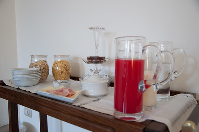Breakfast italian style.  Believe it or not but the pitcher filled with the red juice is Italy's version of orange juice.
