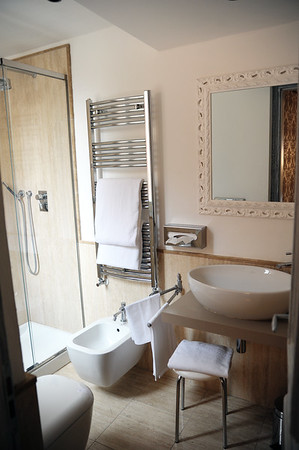All the necessities, super shower, toilet, bidet and sink! Really beautiful suite.