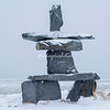 Snow covered Inukshuk overlooking Hudson Bay, Churchill, Canada