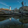 Photographing in the early morning at Peggys Cove, Nova Scotia, Canada