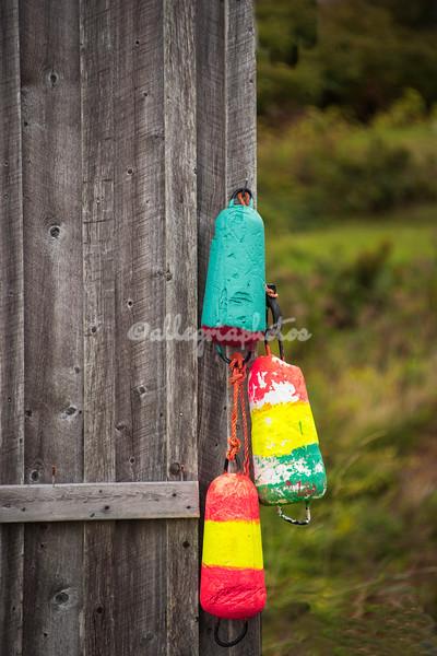 Three multicolored buoys, Peggy's Cove