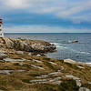 Fishing boat rounds the point near Peggy Cove Lighthouse, Nova Scotia