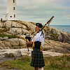 A bagpiper at the lighthouse, Peggy's Cove
