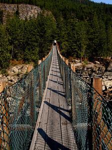 the swinging bridge across the river