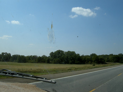 windshield photos of Kansas, just to remember where we were, bug splats included