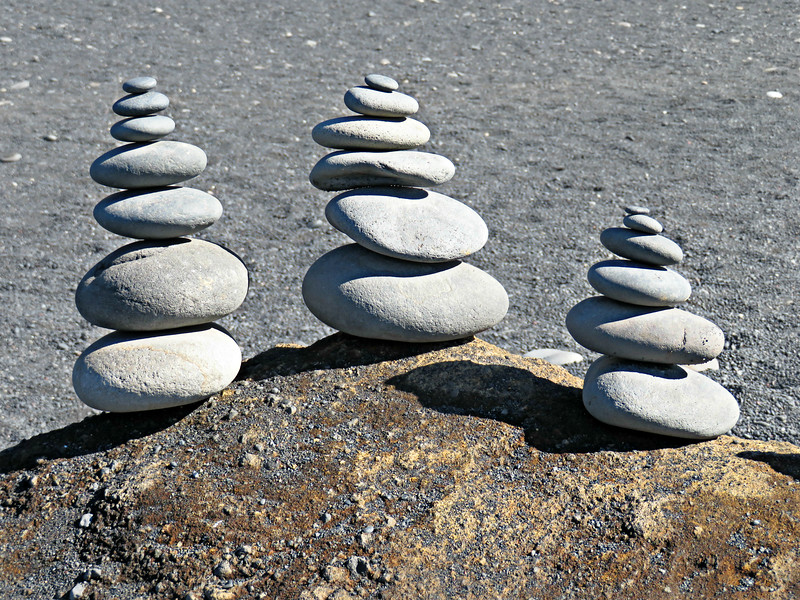 Cairns on a black sand beach, Iceland