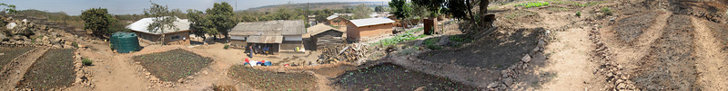 Living Compassion Compound in Kantolomba - View from hill top downby garden area to main building, water supply and kitchen area