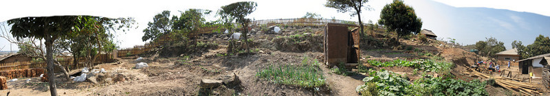 Living Compassion Compound in Kantolomba - View up the hill and around to the kitchen area