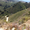 Mtn Bike ride up Sierra Grade on Old Coast Road - view West with road below and Pacific Ocean in distance