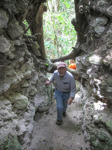 Bob Carr entering looters cave in El Pilar