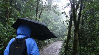 Laura hiking thru the wild weather