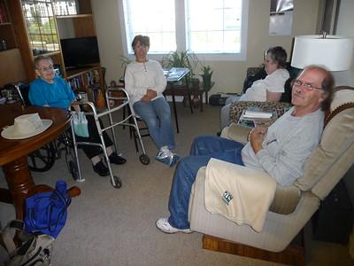 Mom, Shirley, Linda, and Al in Mom's living room at Good Samaritan