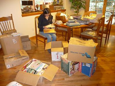 Andrea sorting her memorabilia