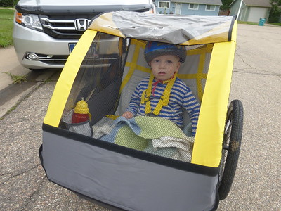 Otto set to go for his first ride in the bike trailer.