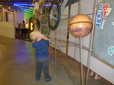 Otto at the Discovery Center.  He likes anything with wheels.