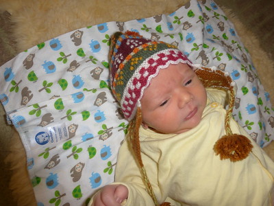 Finn not sure what to make of wearing the hat from Peru.
