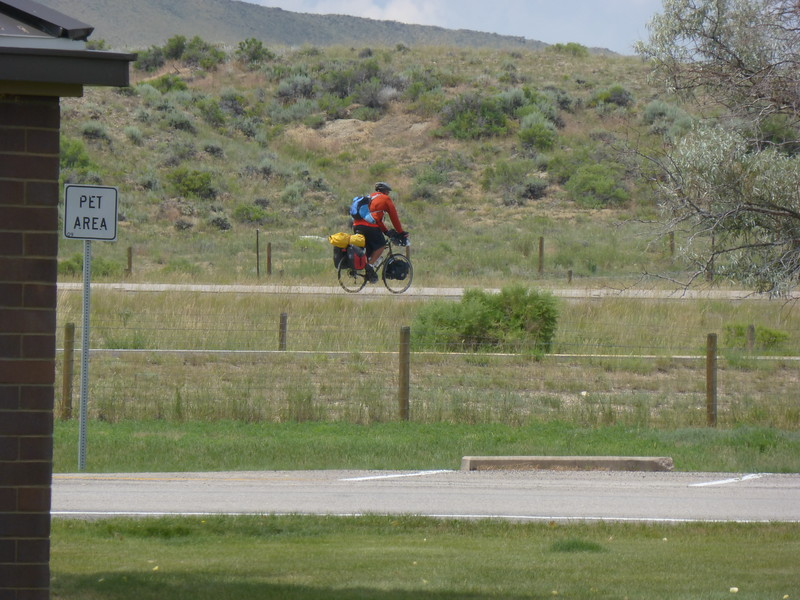 Loaded cyclist braving I-80 in Wyoming