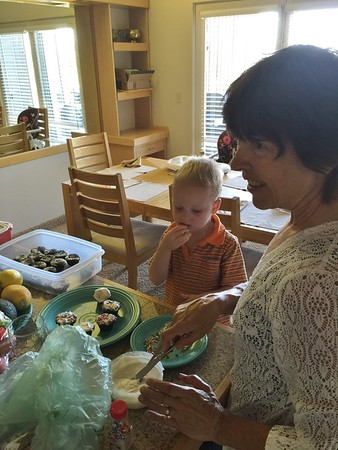 Otto helping Grandma Shirley to decorate cupcakes