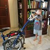 Dash is fascinated by the foldable bike.