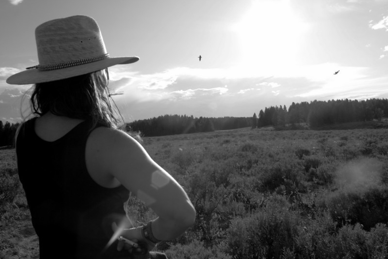 Cowgirl and Meadow. Michelle Osgood enjoying the view. Love Lake Area, Yellowstone NP