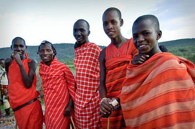 "Young Masai ""Warriers"" They have their blankets and sticks and have survived the circumscision without flinching at all."