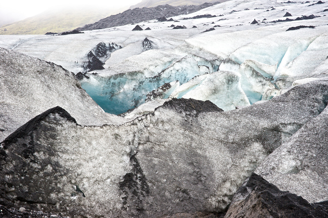 Glacier and blue ice (dirt on surface from blown sand and ash.)