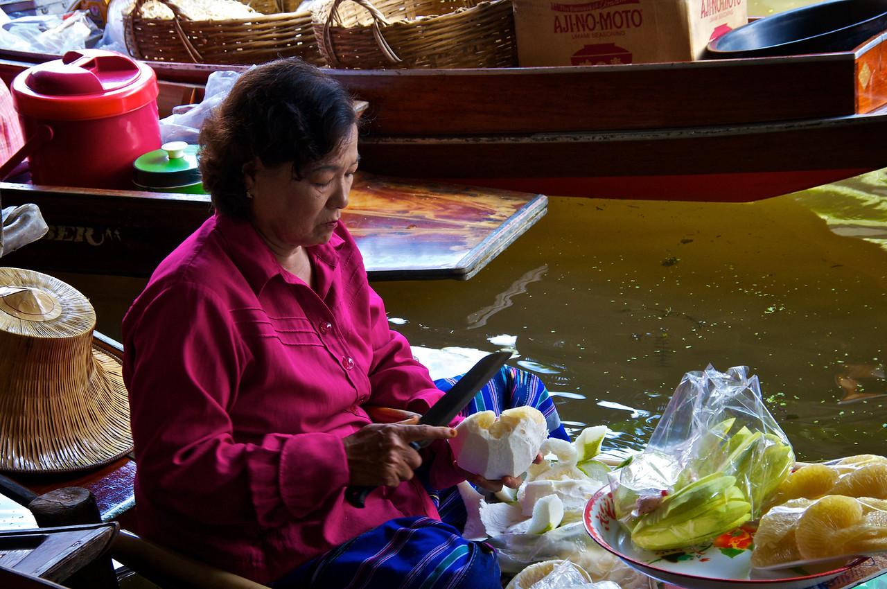 Preparing fruit floating market Mae Kong