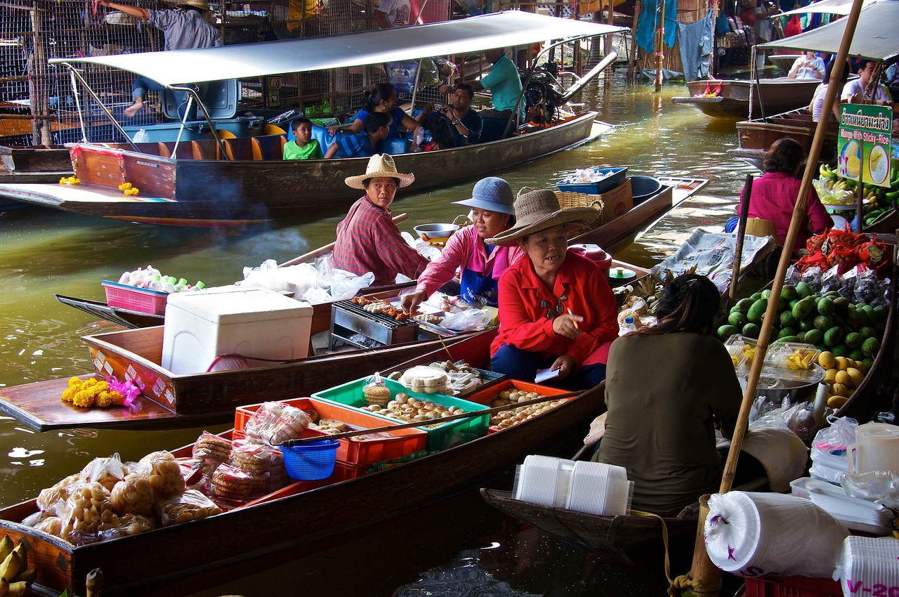 Vendors in boats - floating market Mae Kong
