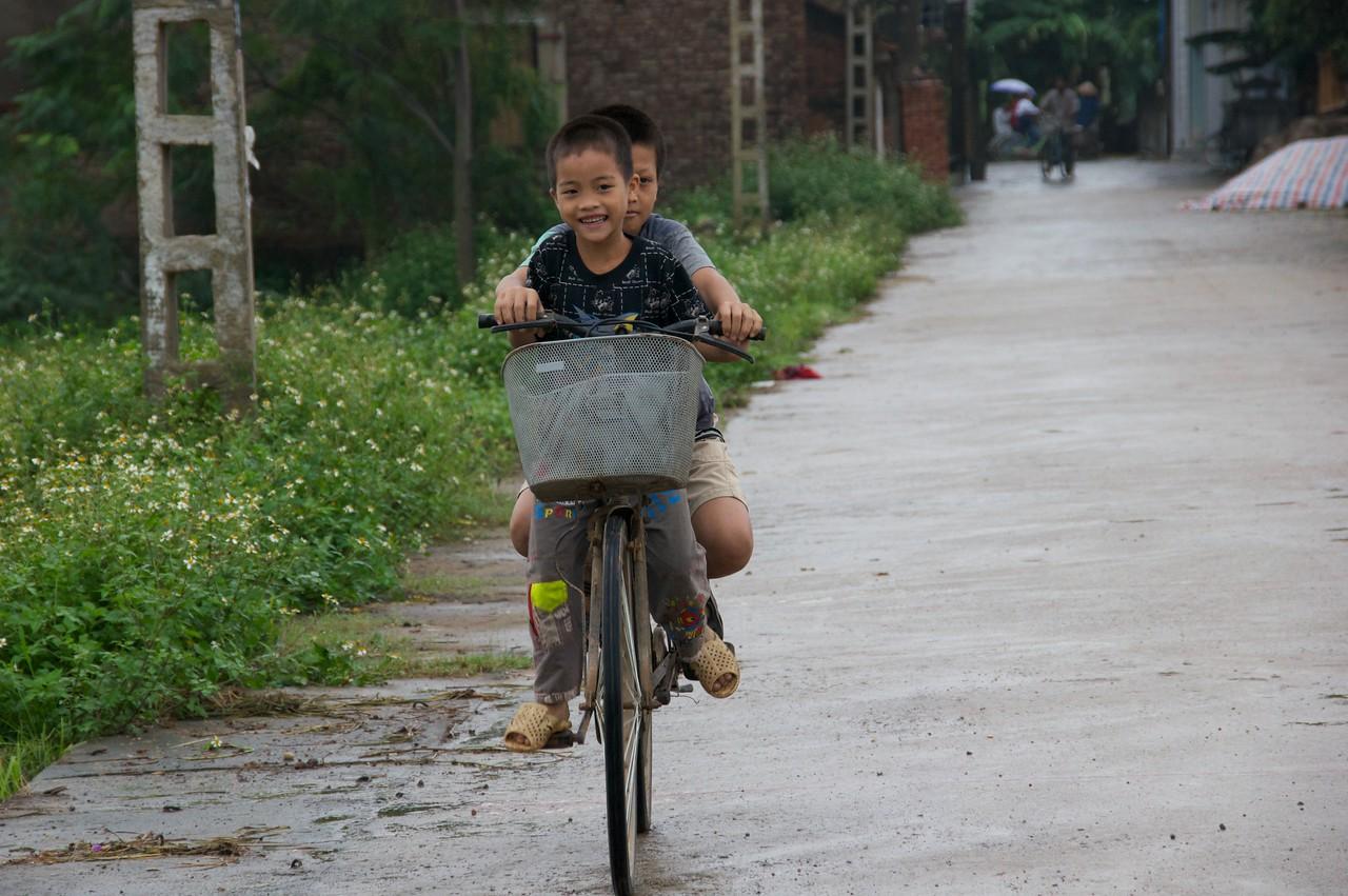 Boys on a bike.