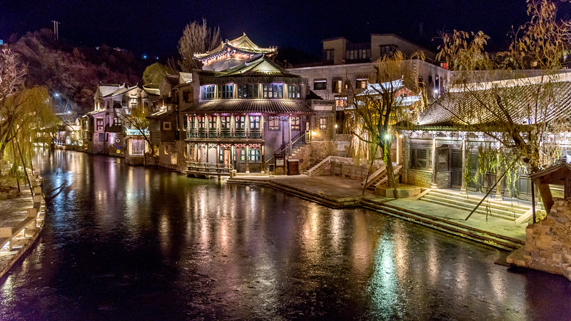 Traditional buildings along a waterway at Gubei Water Town Resort