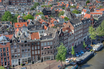 View from the Westerkerk. Westerkerk (west church), where Rembrandt van Rijn is buried, is also the church that Anne Frank often referenced in her famous diary, due to the bells providing comfort being so close to her 2 year long hideout during WWII. Amsterdam.